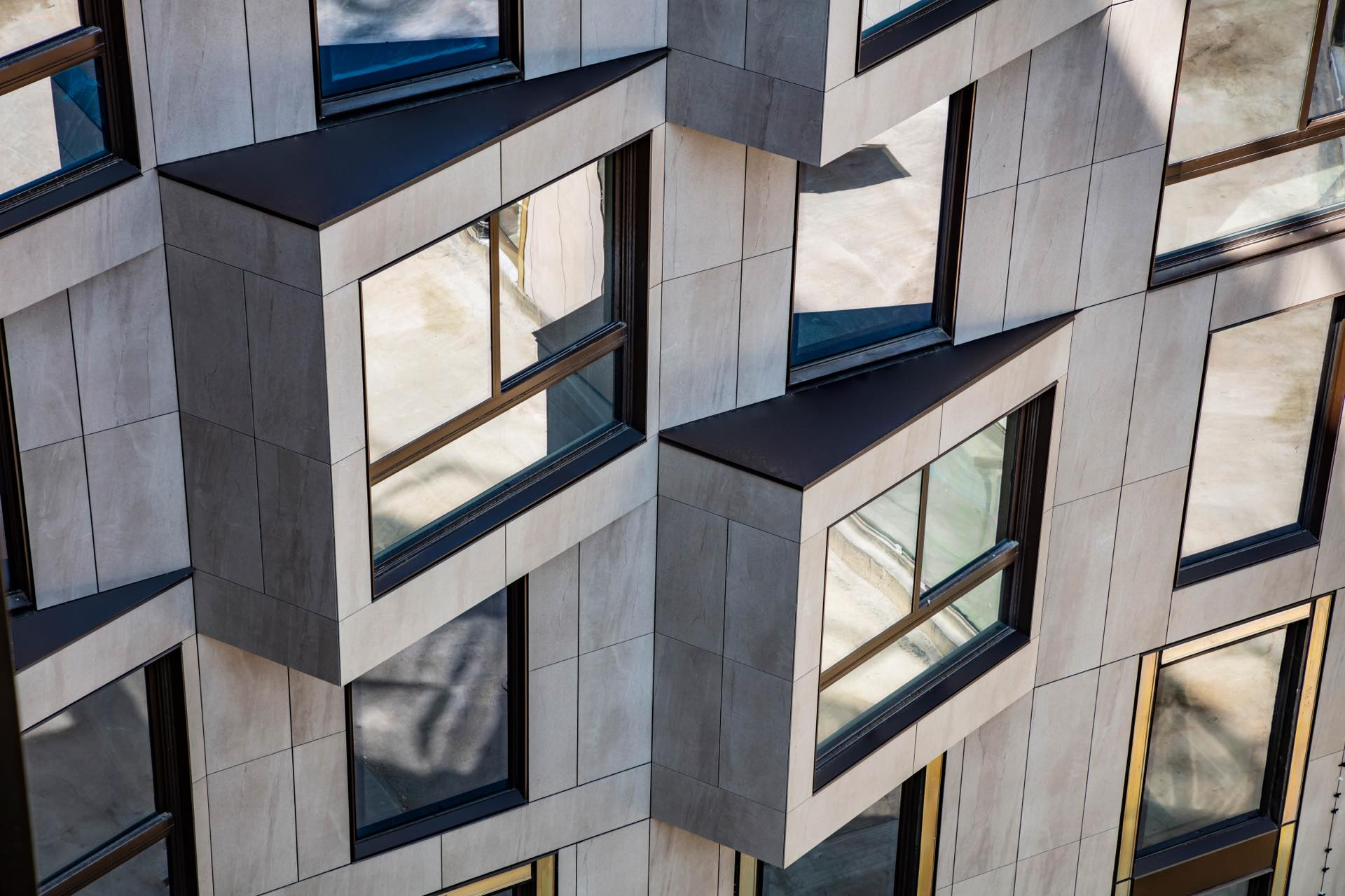 A unique, rhythmic window placement defines the Silva's facade