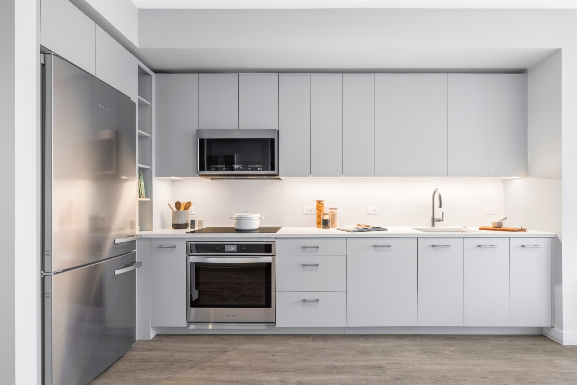 Meticulously designed kitchens featuring a custom trash and recycling drawer