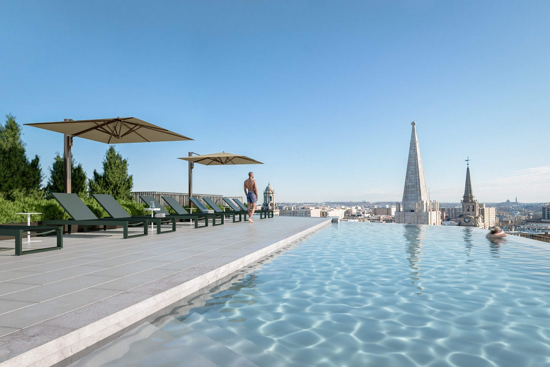 Rooftop infinity pool & deck with expansive city views